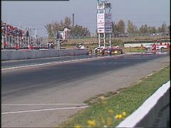 Motorsports, American Indy Car race, front straight tight follow Stock Footage