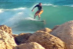 Stock Video Footage of Surfing Rock Wipeout