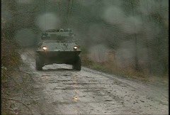 Stock Video Footage of military, armored fighting vehicle in the rain