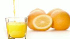 Pouring orange juice Stock Footage