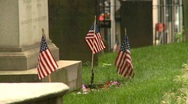 Cemetery headstones and US flags Stock Footage