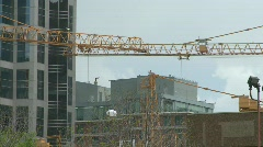 Stock Video Footage of construction cranes moving choreographed