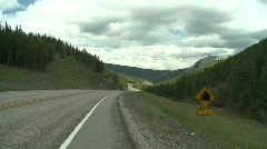Steep mountain road, rock sign Stock Footage