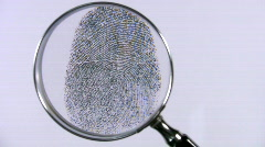 Identity. Finger print examination with a magnifying glass. Stock Footage