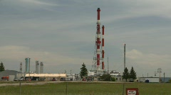 Oil & gas, gas plant and flare stacks, summer day Stock Footage