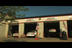 Crane Shot of a generic Auto Repair Shop Stock Footage
