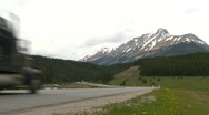 Trucking, Trans-Canada Highway in mountains, chrome fuel tanker Stock Footage