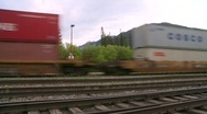 Railroad, intermodal container train fast eastbound wide backlit Stock Footage