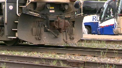 Railroad, freight train leaving slow, tight on wheels Stock Footage