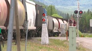 Railroad, freight train leaving slow, long lens, 4/5 angle Stock Footage