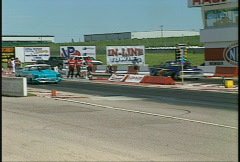 Motorsports, drag racing, Pro mod race, '57 Chevy vs early 70s Chevy pickup Stock Footage