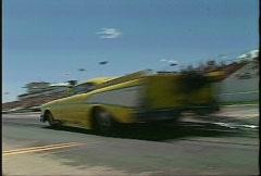 Motorsports, drag racing, Pro mod launch, yellow '57 Chevy Stock Footage