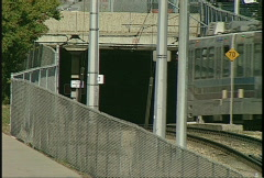 Light rail transit enters tunnel Stock Footage