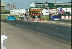 Motorsports, drag racing, Pro mod race, whip pan, 200' mark Stock Footage