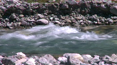River and waterfall, mountain stream, clear water and rounded rocks Stock Footage