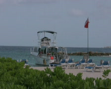 Boat laying for anchor at a pier PAL Stock Footage
