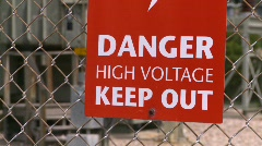 Sign, high voltage sign, electrical substation Stock Footage
