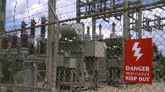 Electric substation, #1 and high voltage sign close up Stock Footage