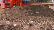 Construction, backhoe scooping dirt, #2 tight frame Stock Footage