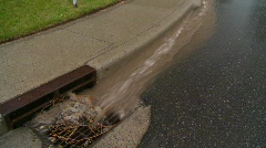 Weather, rainwater flowing into gutter Stock Footage