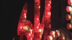 Red and white lights flash rhythmically on a sign.  Stock Footage