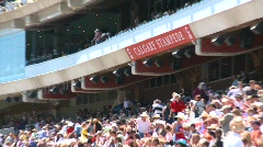 People, grandstand full of people, zoom back reverse angle Stock Footage