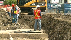 Construction, backhoe trenching, #6 medium long with workers Stock Footage