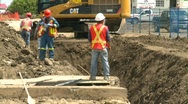 Stock Video Footage of construction, backhoe trenching, #6 medium long with workers