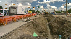 Construction, backhoe trenching, #4 and traffic Stock Footage
