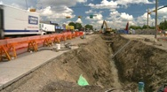 Stock Video Footage of construction, backhoe trenching, #4 and traffic