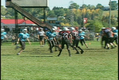 Sports and fitness, kids football, #6 tackle Stock Footage