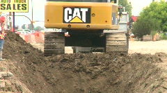 Construction, backhoe trenching, #5 long shot with workers Stock Footage