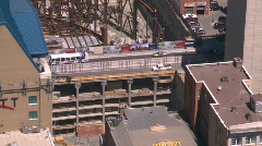 Construction site and road bridge, aerial, The Bow (58 stories) Stock Footage