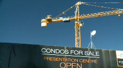 Construction crane with Condo signage - stock footage