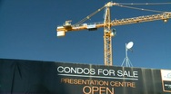 Construction crane with Condo signage Stock Footage