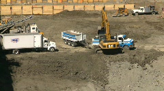 Construction site backhoe dumptruck Eighth Avenue Place, #1 Stock Footage