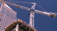 Construction crane, lifting and rotating concrete bucket Stock Footage
