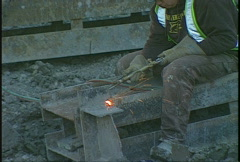 Construction, cutting torch on construction site Stock Footage