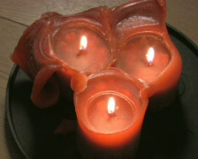 Three red candles burning PAL Stock Footage