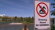 Drowning hazard, #4 sign and river Stock Footage