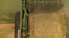 Agriculture, tractor harvesting, #6 unloading hay roll Stock Footage