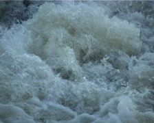 Boiling and spuming water on weir Stock Footage