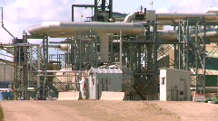 Oil & gas, gas plant, stack and tanks zoom to medium Stock Footage