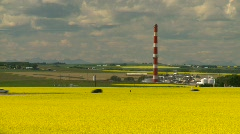 Agriculture, canola fields and gas plant Stock Footage