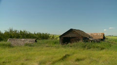 Outbuilding and abandoned farm house Stock Footage