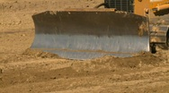 Stock Video Footage of construction, caterpillar scraper, follow shot on blade