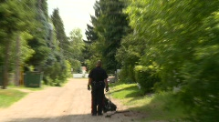 Crime and justice, police K9 unit, handler and dog #2 Stock Footage