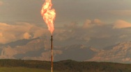 Stock Video Footage of oil & gas, gas flare and mountains, dawn