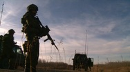 Military, soldier and trucks, standing guard Stock Footage