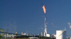 Oil & gas plant and flare, big flame, morning Stock Footage
